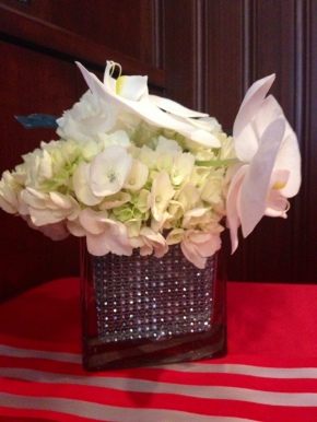 Holiday flower vase created from metallic mesh attached with glue tabs inside a glass container. Idea from Flourish Event and Floral Design, photo taken by blogger Karen LeBlanc